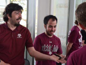 Graduate student holding millipede
